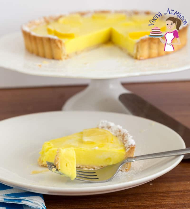 Cut into the slice of lemon curd tart, tarte au citron