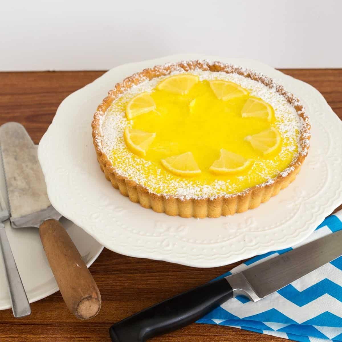 A lemon tart on a cake stand