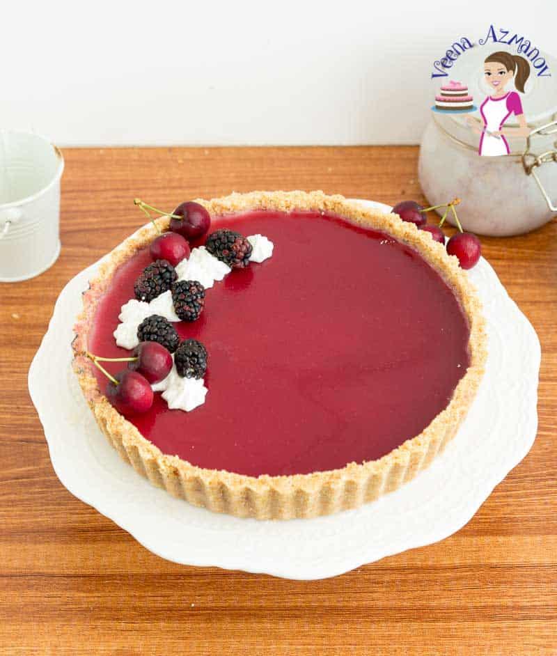 Garnish the panna cotta tart with fresh blackberries and whipped cream