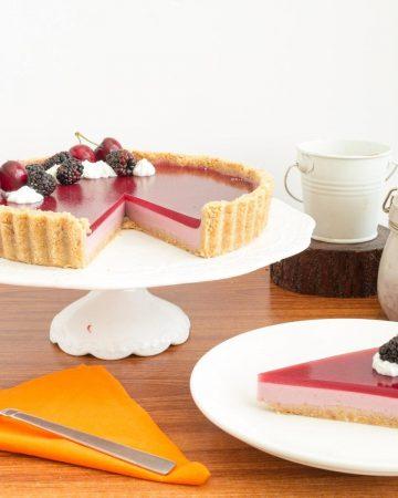 Cake stand with blackberry panna cotta tart.