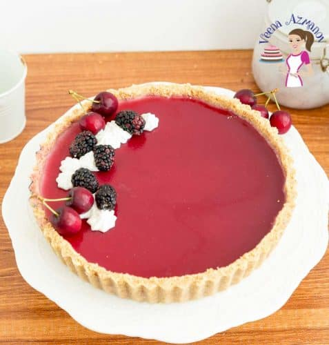 Garnish the panna cotta tart with fresh blackberries and whipped cream