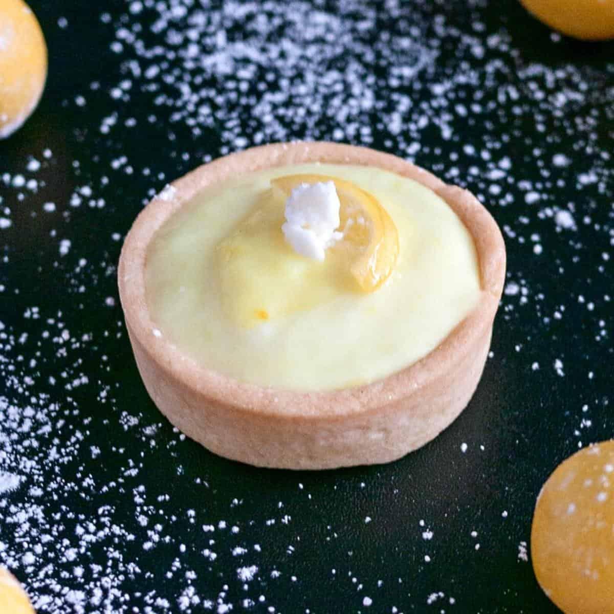 Mini tart filling with lemon cheesecake filling.