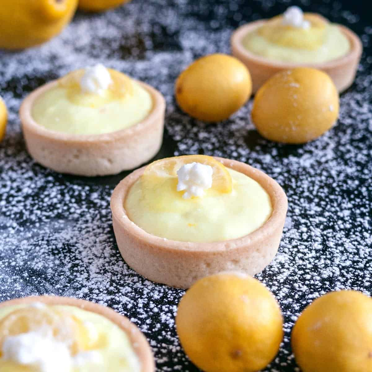 Tartlets dusted with powdered sugar.
