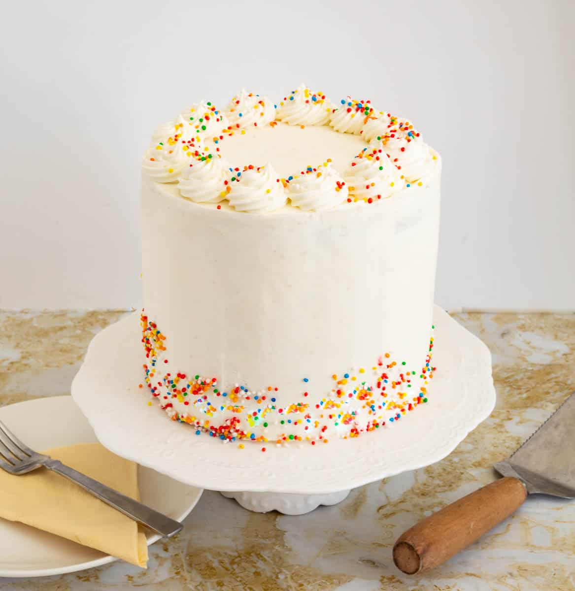 Frosted cake on a cake stand