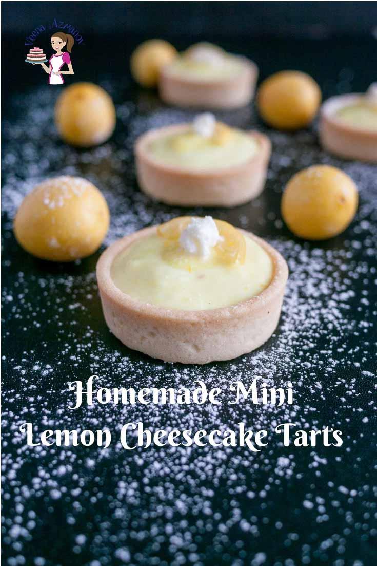 A mini lemon cheesecake tart on a table.
