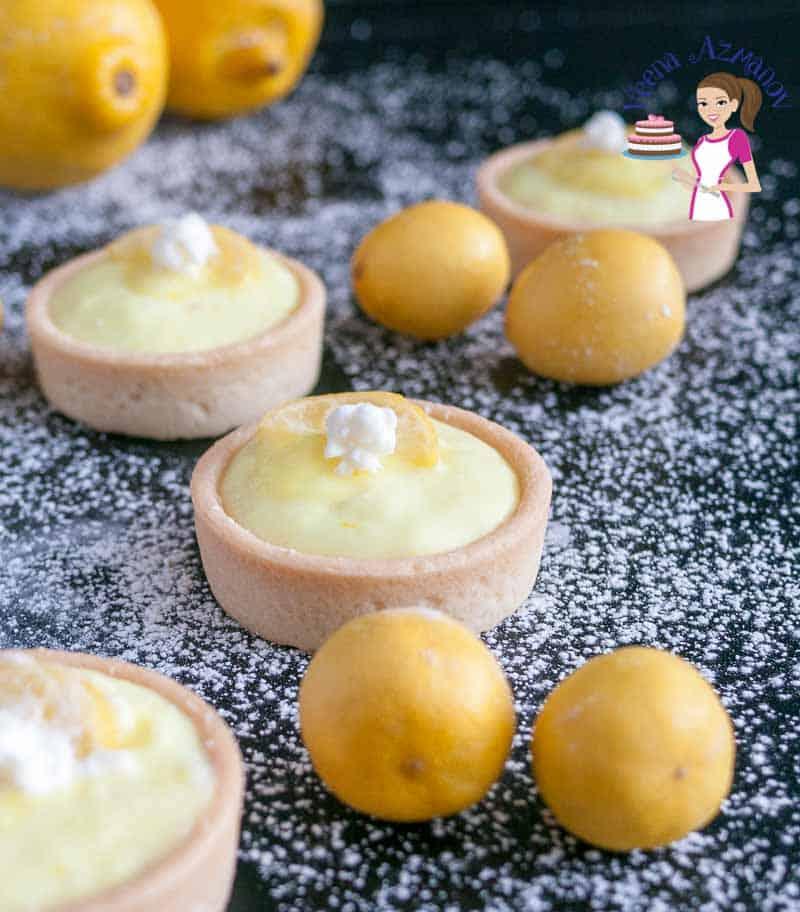 Mini lemon tarts on a table.