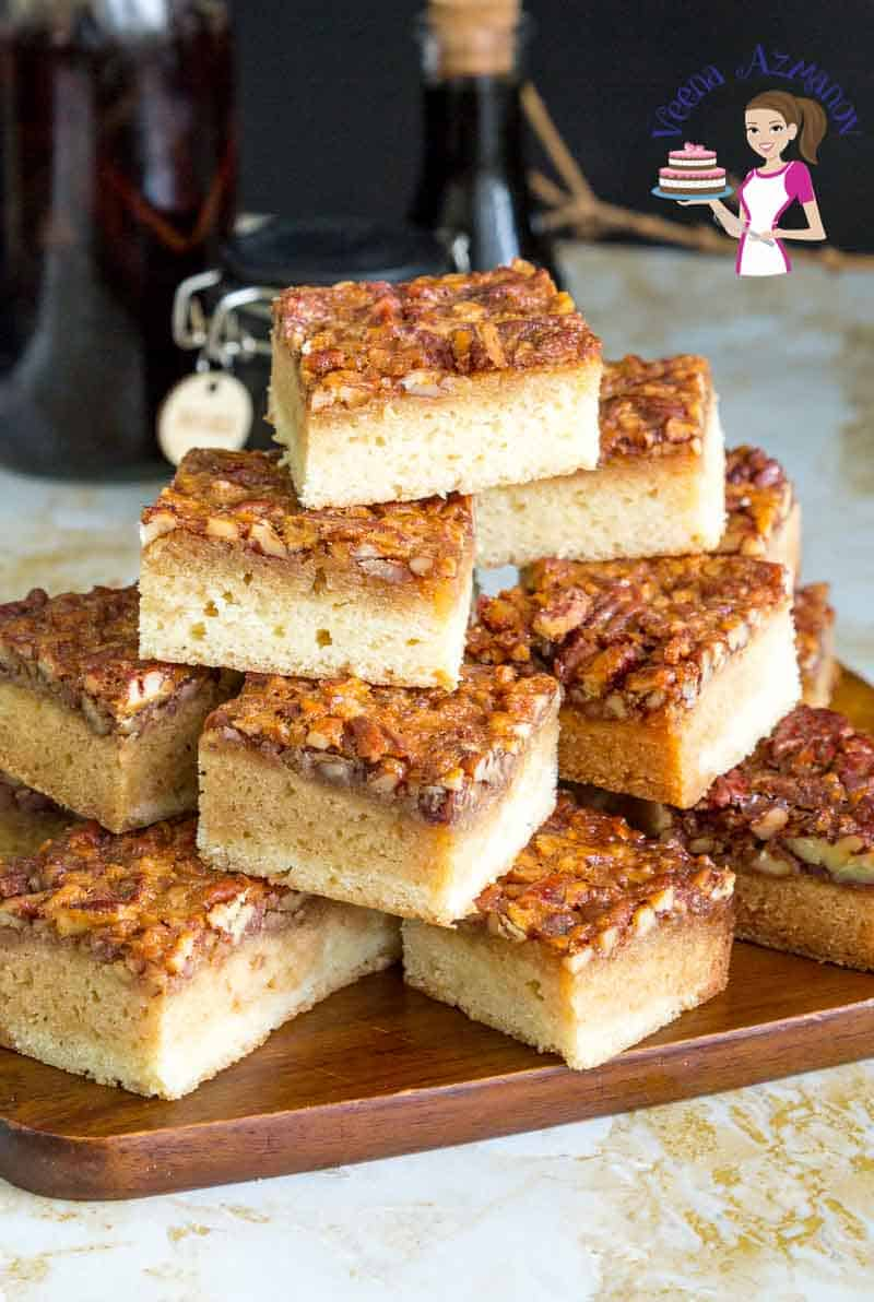 A stack of blondies on a wooden board