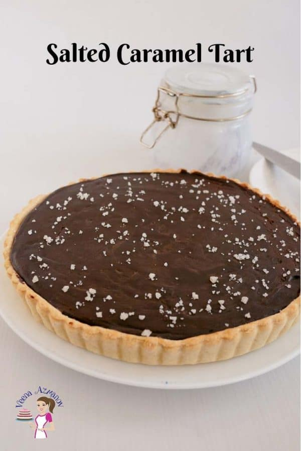 A chocolate tart on a plate.