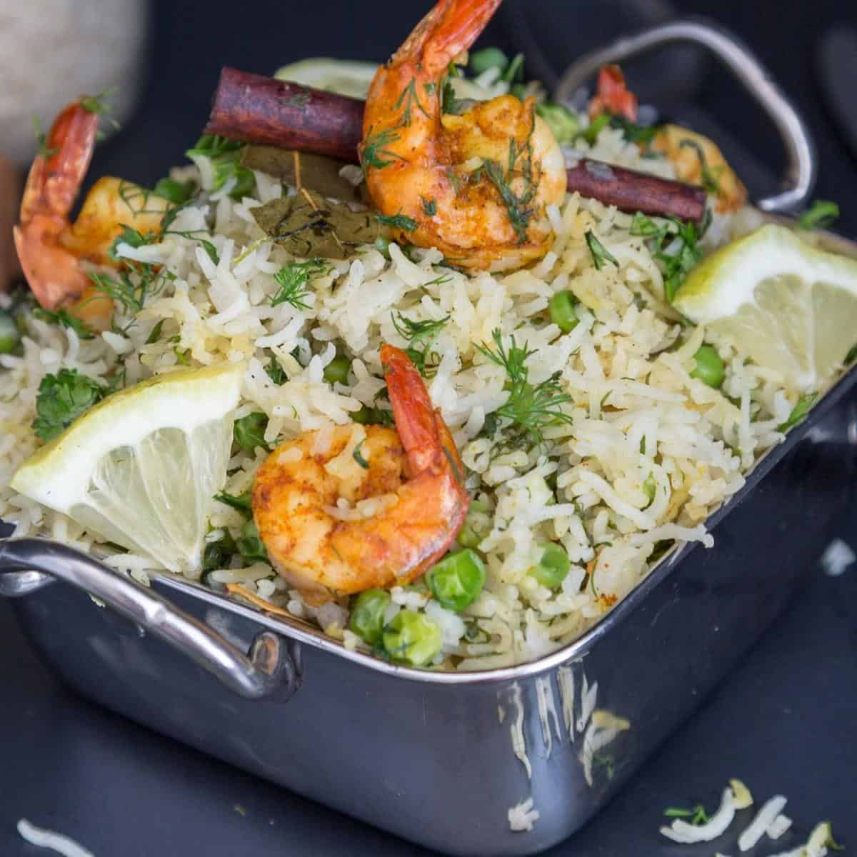 A skillet with shrimps and rice.