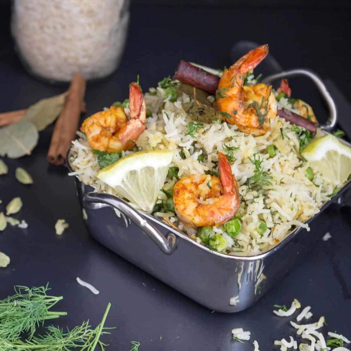 Shrimps over a bed of rice pilaf.