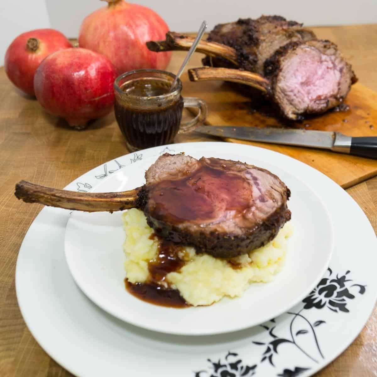 A plate with mashed potato and prime rib.