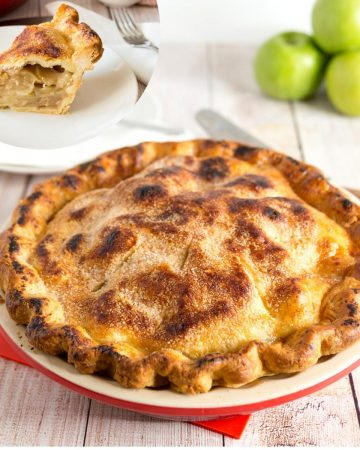 An apple pie in a pan on a table.