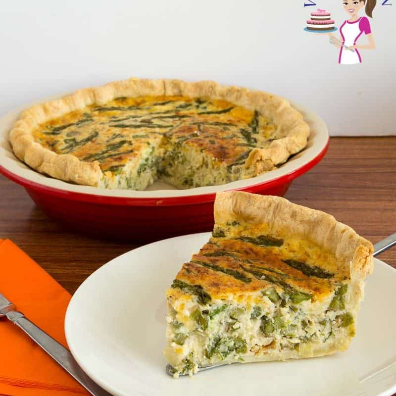 A slice of asparagus and leek quiche on a plate.