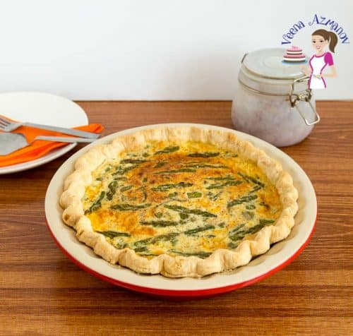 An asparagus and leek quiche in a pan.