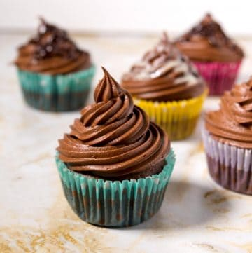 Five chocolate frosted cupcakes