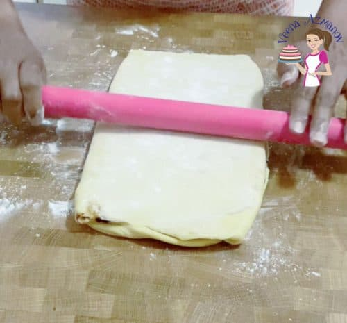 Rolling the rugalach dough into a triangle for making rugalach