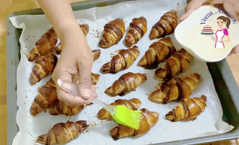 Brush the baked chocolate rugelach with sugar syrup