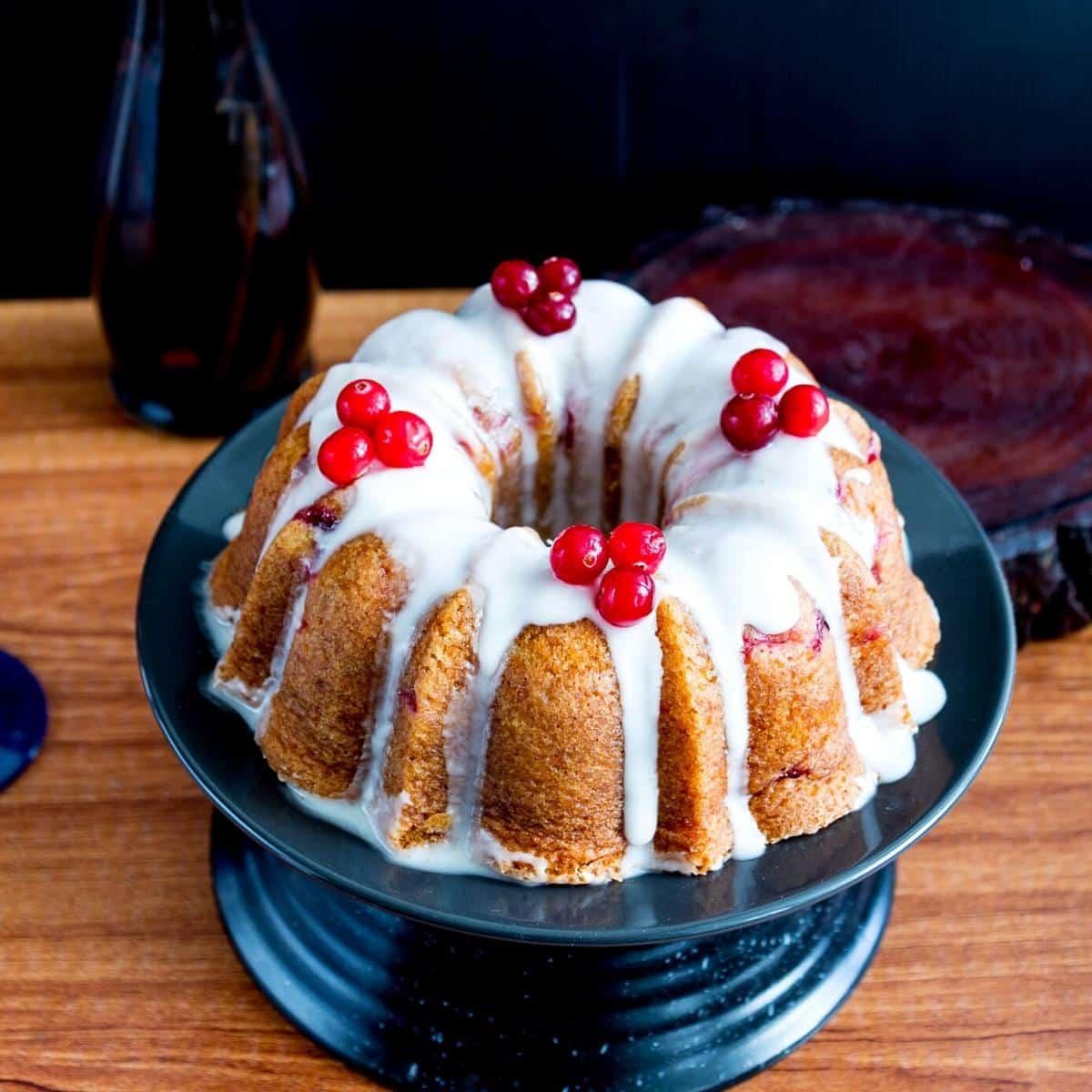 A glaze bundt cake on a cake board