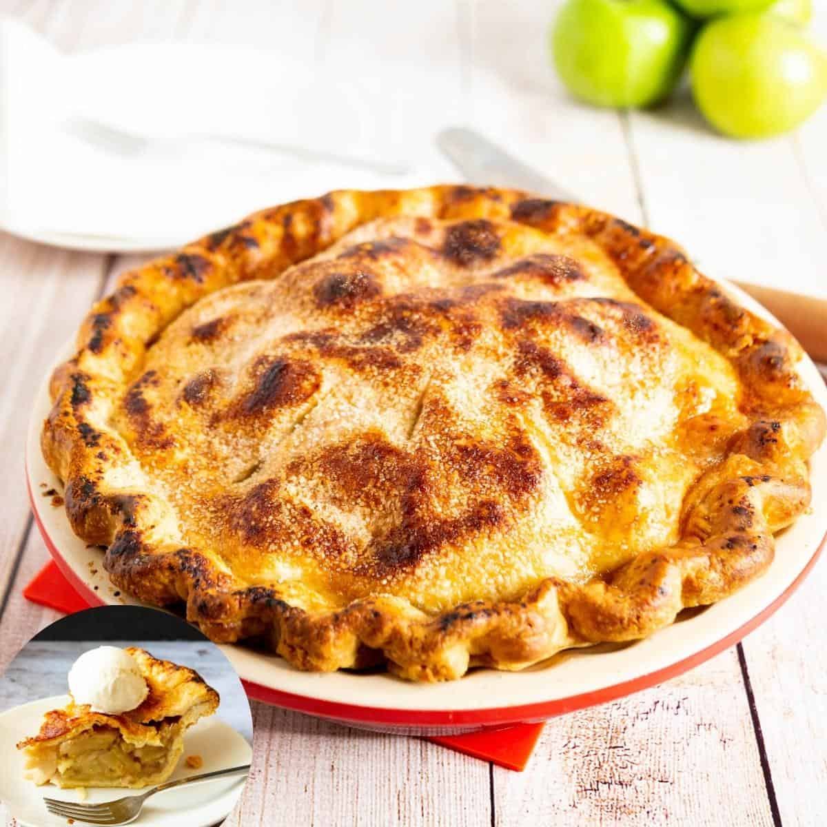 A pie on a pie plate with apples on the back.