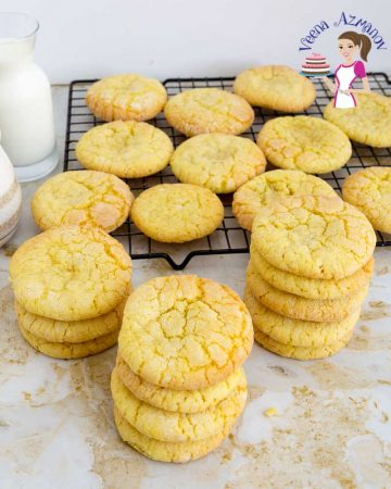 A stack of lemon crinkle cookies on a table.