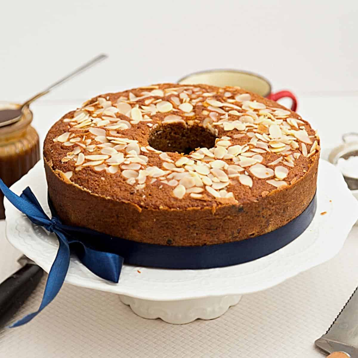 A fruitcake on a cake stand.
