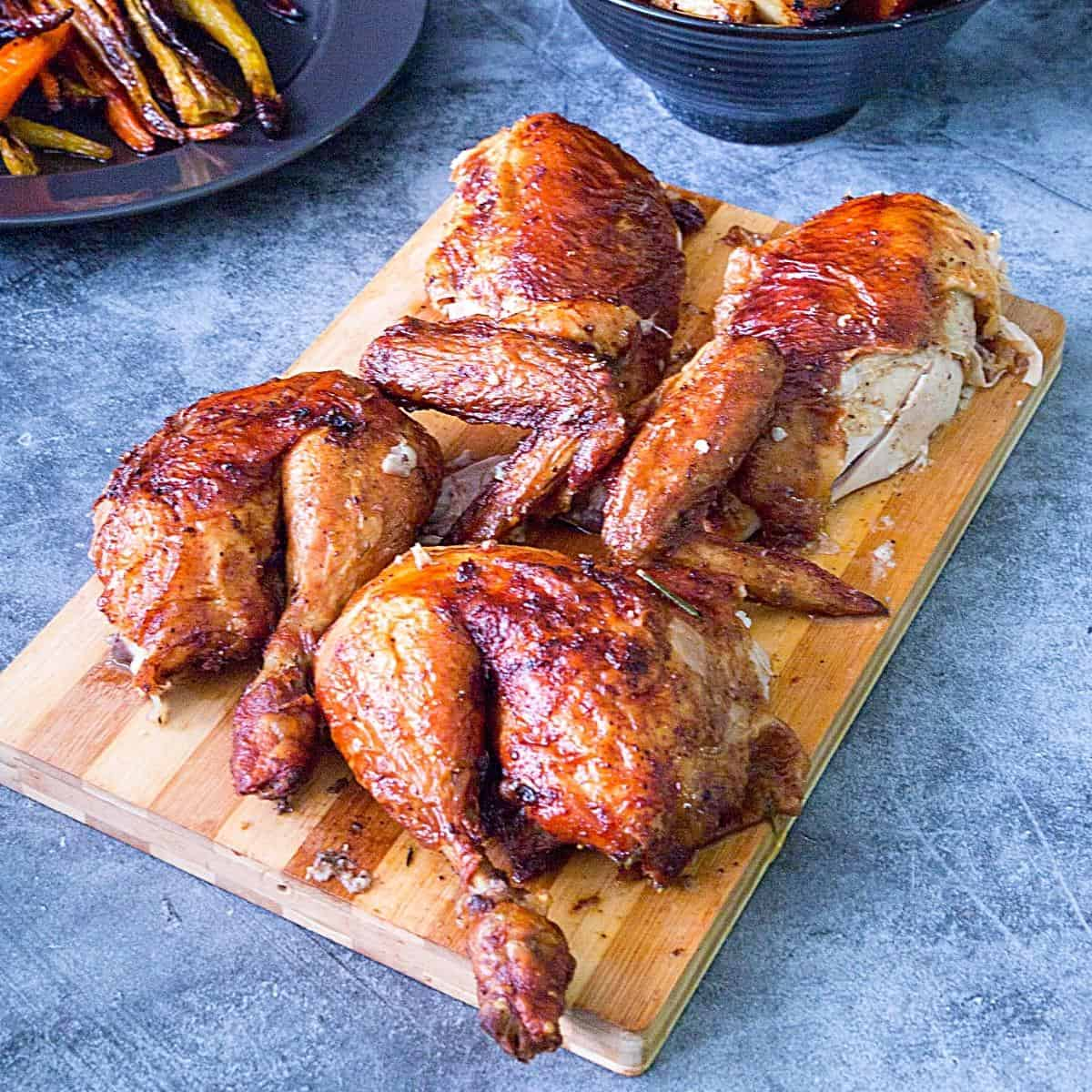 A carved roasted chicken in the oven.