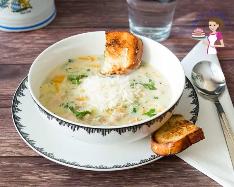 A bowl of chicken pot pie soup on a table.