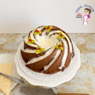 An eggnog bundt cake on a cake stand.