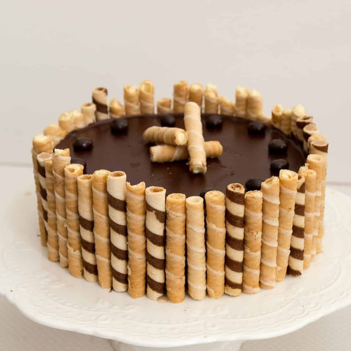 A chocolate torte surrounded by wafers.