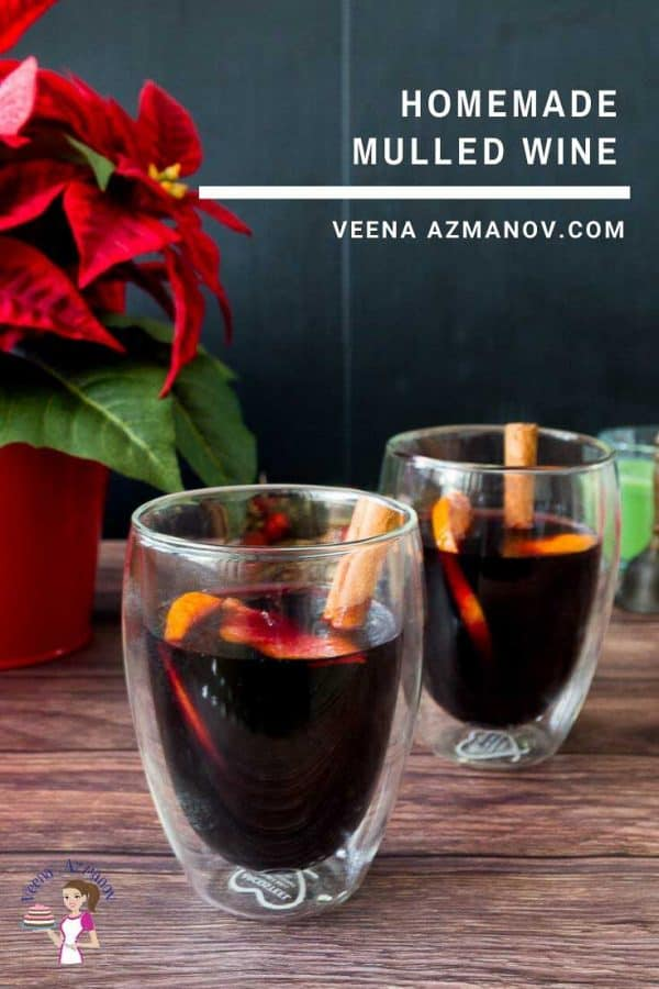 Two glasses of mulled red wine on a table.