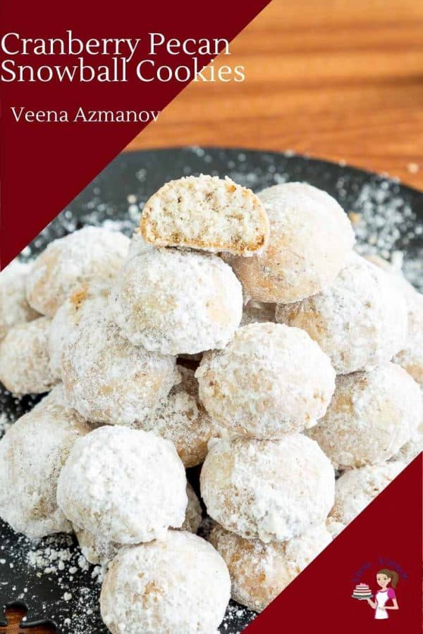 A stack of pecan and cranberries snowball cookies on a plate.