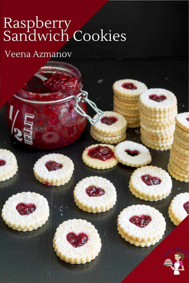 These raspberry Linzer cookies are classic Christmas sandwich cookies. Buttery shortbread sugar cookies filled with jam make perfect tea time treats as well as gifts to family and friends during Christmas. #raspberry #linzercookies #sandwichcookies #raspberrycookies #cookierecipes #Christmascookies #shortbreadcookies via @Veenaazmanov