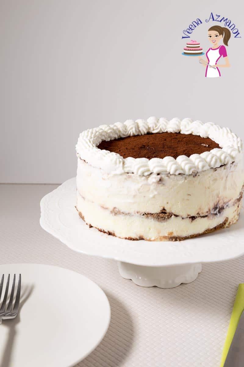 A tiramisu cake on a cake stand.