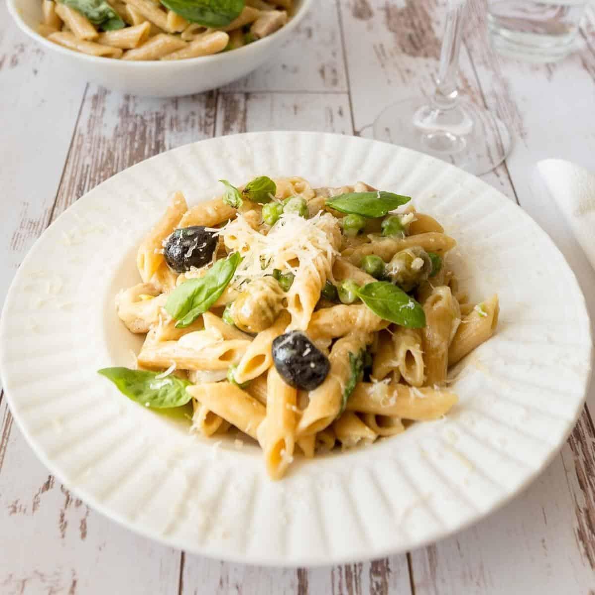 Chicken pasta recipe in a white plate.