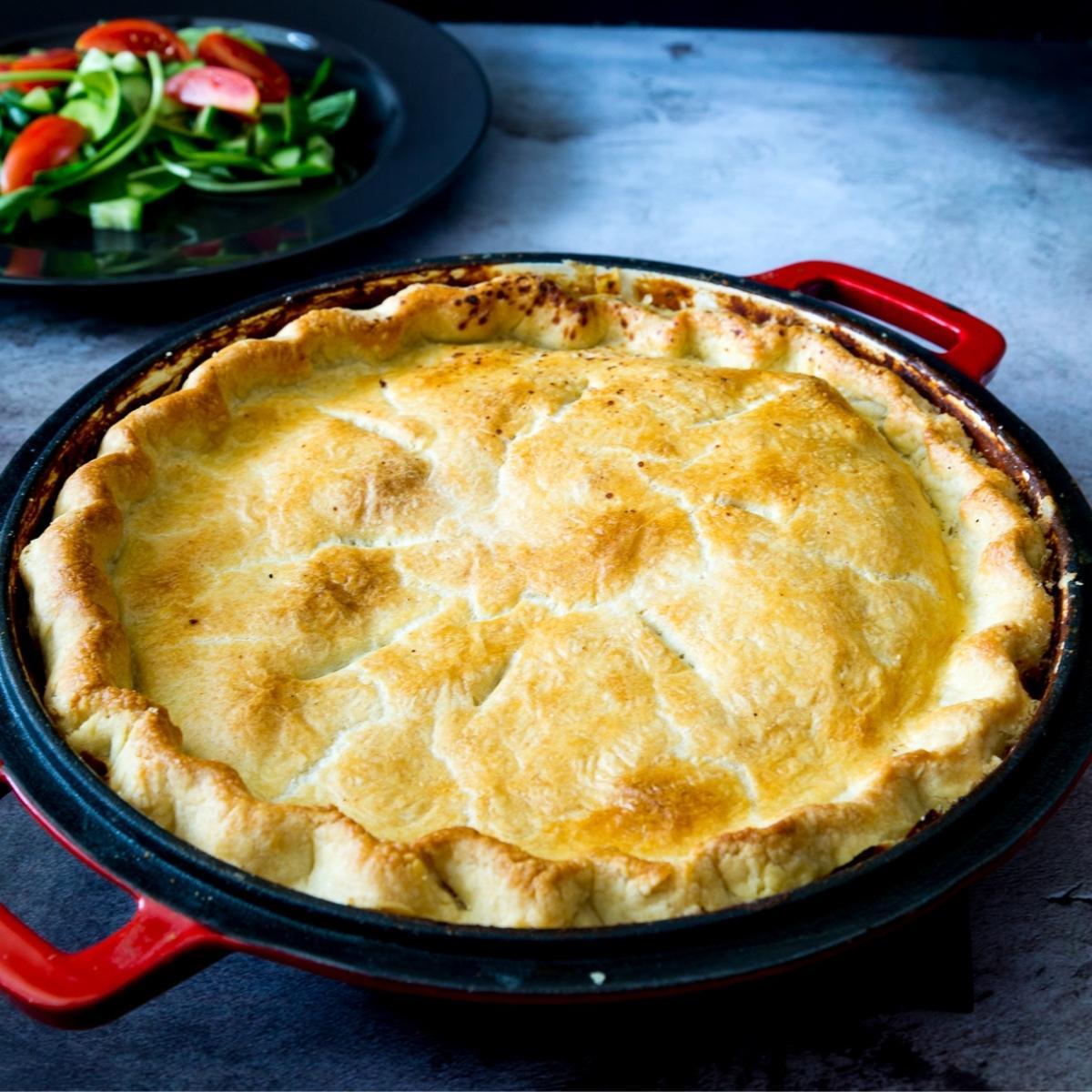 A skillet with chicken pot pie recipe