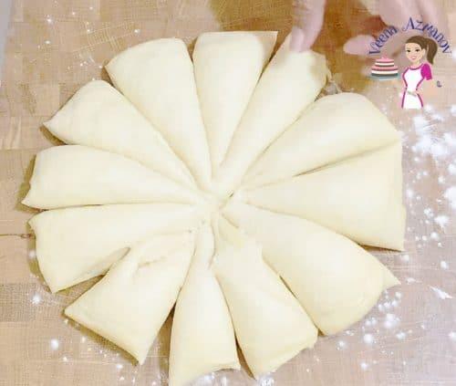 Dividing the bread dough for dinner rolls