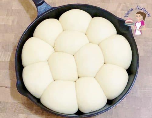 Rising the dough for homemade dinner bread rolls