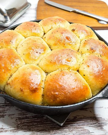 Garlic rolls baked in a cast iron skillet.