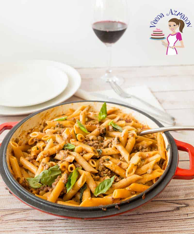 Ground beef with penne pasta in a pan.