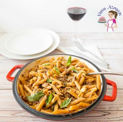 A bowl of pasta with ground beef.