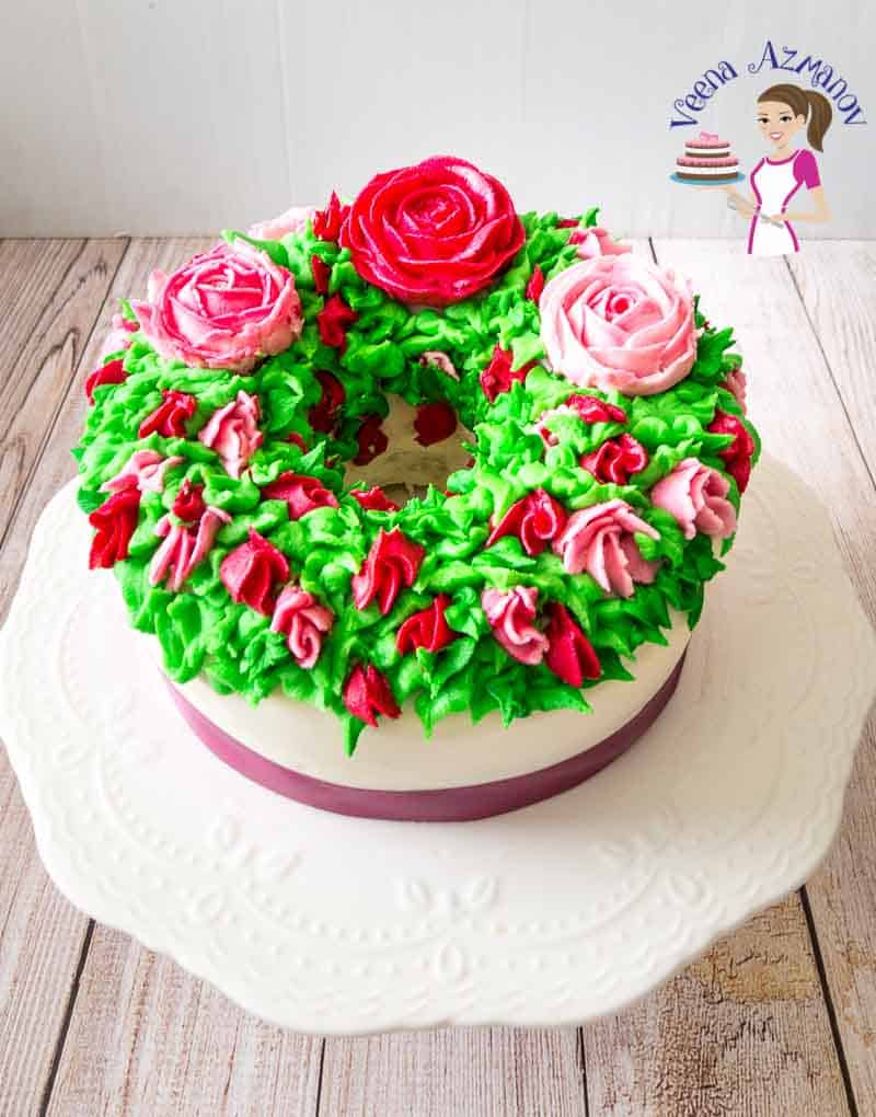 A cake decorated with flowers made with Korean buttercream frosting.