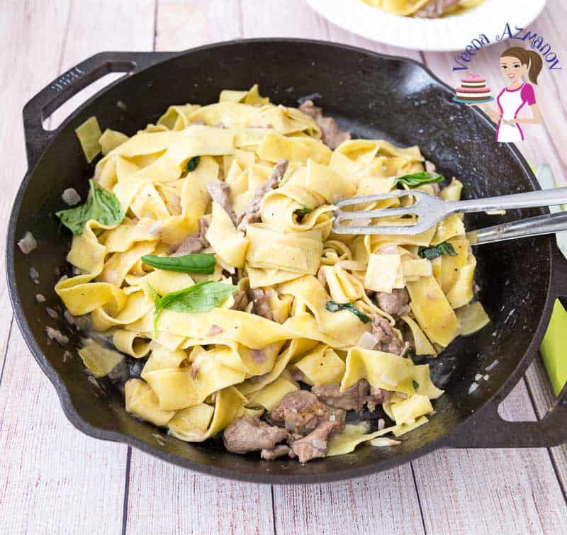 A pan of pappardelle pasta with lamb.