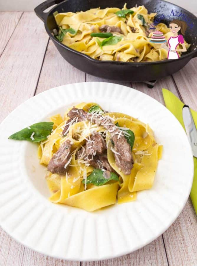 A of pappardelle pasta with lamb on a table.