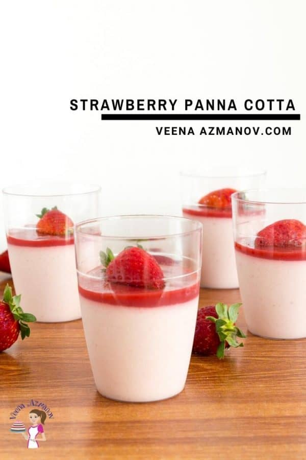 A glass of Strawberry Panna cotta on a wooden board.