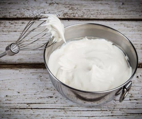 Whipped cream in a mixing bowl.