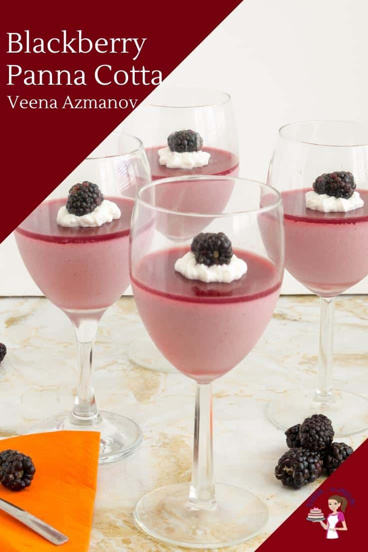 4 wine glasses filled with blackberry Panna Cotta.