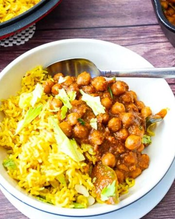 A bowl with turmeric rice and chickpeas curry.