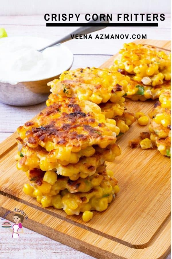 A stack of corn fritters on a wooden board.