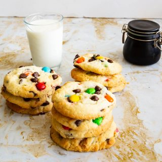 A stack of M&M cookies on a table.