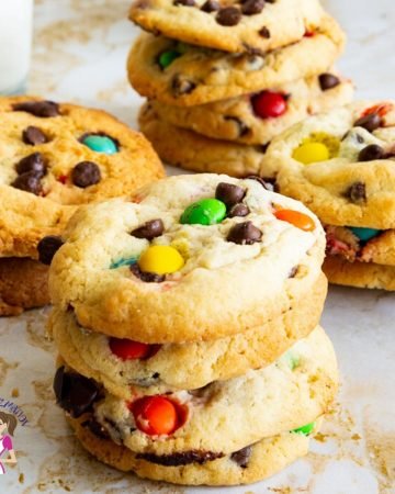 A stack of chocolate chip cookies with M&M candy.